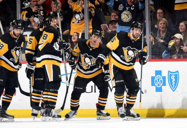 Riley Sheahan (right) scored Pittsburgh first goal of the game in the second period. Photo: Joe Sargent/Getty Images