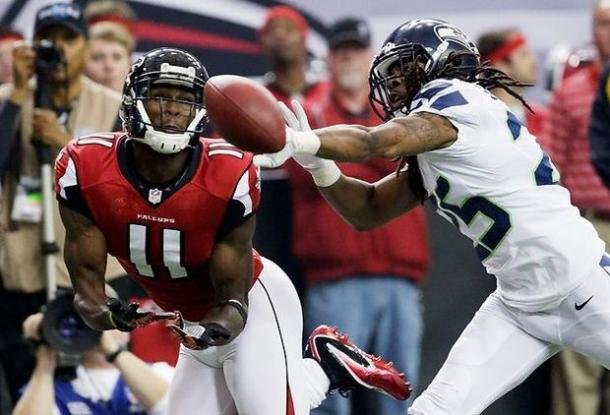 Richard Sherman defends a pass to Julio Jones during the NFC Divisional Round in January 2013 | Source: AP Photo