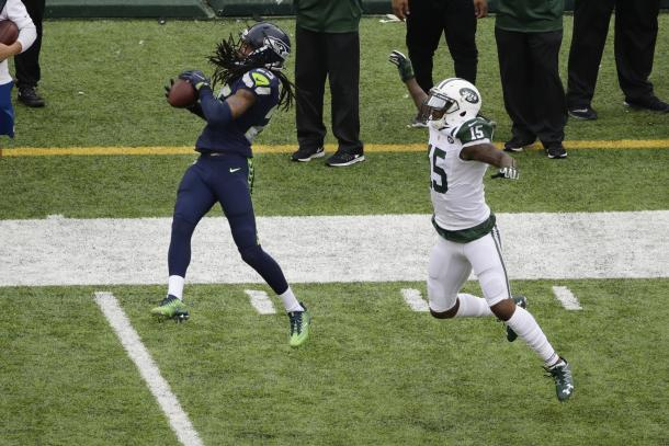 Richard Sherman intercepting his first pass of the season against the New York Jets | Source: Peter Morgan - AP Photo