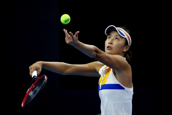 Peng Shuai serves at the China Open | Photo: Emmanuel Wong/Getty Images AsiaPac