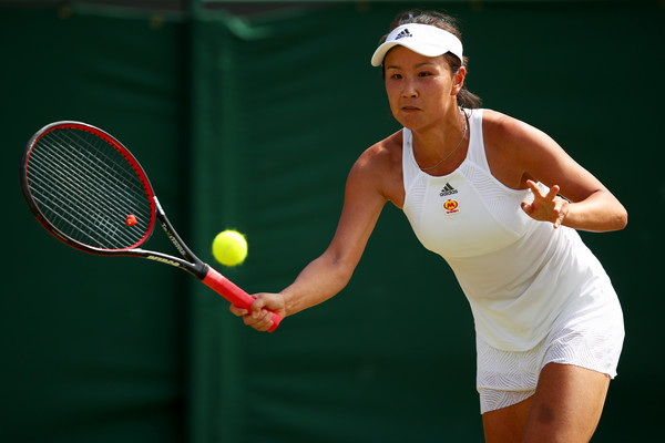 Peng Shuai in action at the Wimbledon Championships during her third-round loss to Simona Halep | Photo: Clive Brunskill/Getty Images Europe