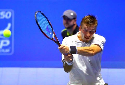 Alexandre Sidorenko hits a backhand during his upset win. Photo: St. Petersburg Open