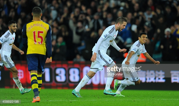 Gylfi Sigurdsson celebrating his goal in Swansea's 2-1 win at home to Arsenal back in 2014. (Image by Getty Images/Stu Forster)