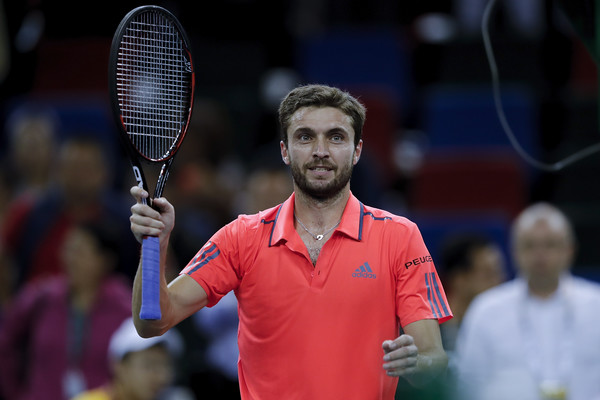 Gilles Simon celebrates his win over Jack Sock. Photo: Lintao Zhang/Getty Images