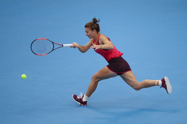 Always on the move: Simona Halep hits a running forehand during her third-round win over Maria Sharapova at the 2017 China Open. | Photo: Zhang Lintao/Getty Images