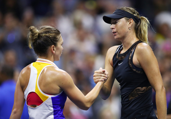 Maria Sharapova (R) and Simona Halep shake hands after their first-round battle at the 2017 U.S. Open. | Photo: Clive Brunskill/Getty Images