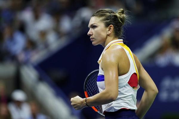 Simona Halep celebrates after winning a point during her first-round match against Maria Sharapova at the 2017 U.S. Open. | Photo: Elsa/Getty Images