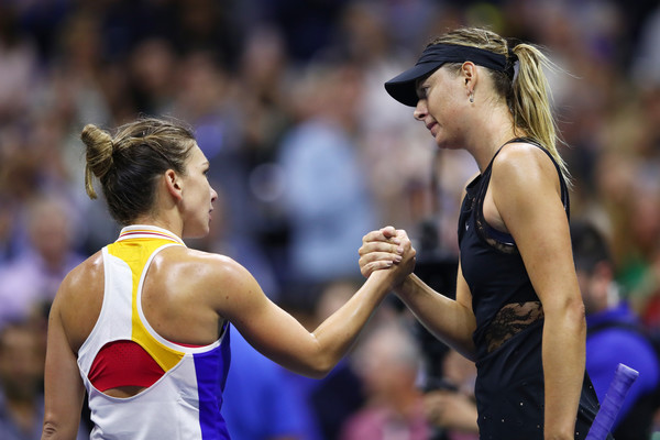 Sharapova and Halep meet at the net after their marathon encounter | Photo: Clive Brunskill/Getty Images North America