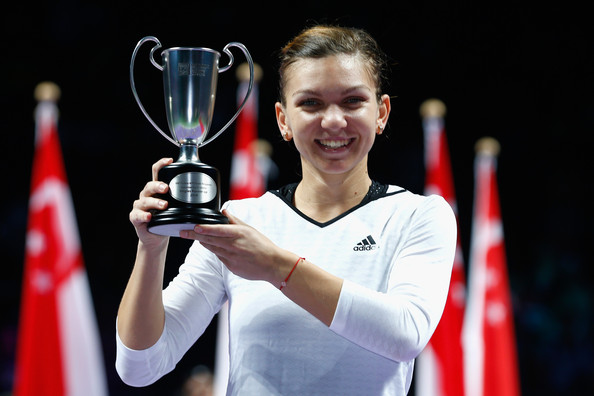 Simona Halep poses along with her runner-up trophy at the WTA Finals back in 2014 | Photo: Julian Finney/Getty Images AsiaPac