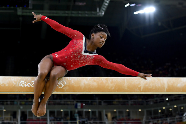 Simone Biles of the United States competes on the balance beam during the individual event finals at the Olympics/Photo: Laurence Griffiths/Getty Images
