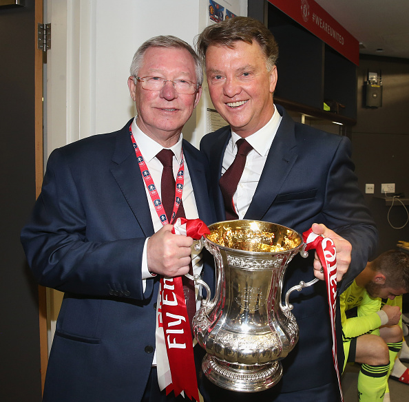Louis van Gaal holds the FA Cup with former-manager Sir Alex Ferguson | Photo: Matthew Peters/Manchester United