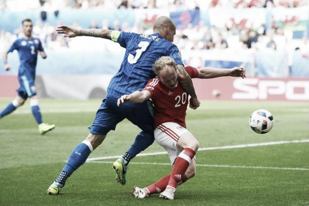Skrtel was lucky to remain on the found following his foul on Jonny Williams (image: irishmirror.ie)