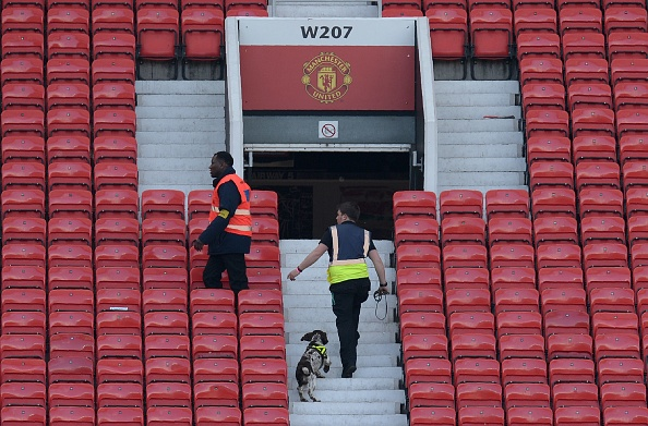 Sniffer dogs in the stands at Old Trafford | Photo: Oli Scarff/AFP