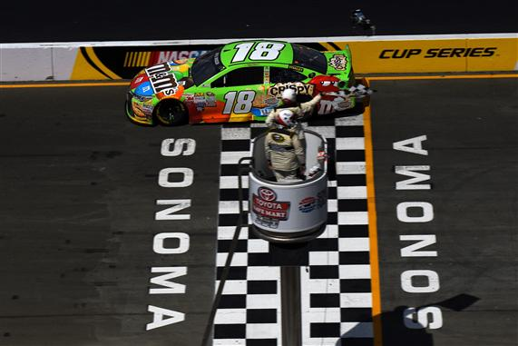 Kyle Busch, driver of the #18 M&M's Crispy Toyota, crosses the finish line to win the NASCAR Sprint Cup Series Toyota/Save Mart 350 at Sonoma Raceway on June 28, 2015 in Sonoma, California. Jonathan Moore/Getty Images