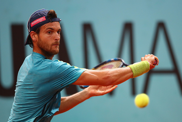Joao Sousa reaches for a backhand during his round of 16 win. Photo: Clive Brunskill/Getty Images