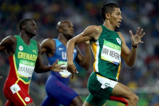 Wayde Van Niekerk holding off Kirani James and LaShawn Merritt to win the 400 meters in Rio/Photo Source: Getty Images