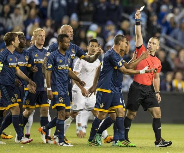The Galaxy players attempting to change the referee's Chris Penso (Right) mind of showing Ashley Cole (Left) his second yellow card on Sunday against SKC at Children's Mercy Park. Photo provided by Brad Davidson- Special to The Kansas City Star.