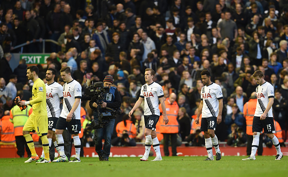 Tottenham Hotspurs walk off the pitch disappointed after drawing Liverpool 1-1. (Getty)