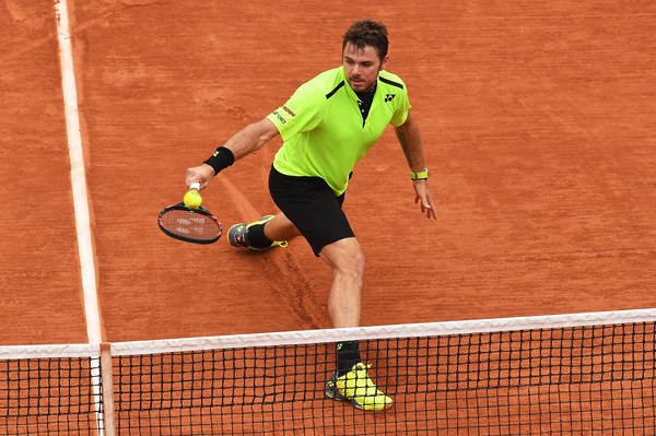 Wawrinka strikes a ball in 2016 French Open action. Photo: Dennis Grombkowski/Getty Images