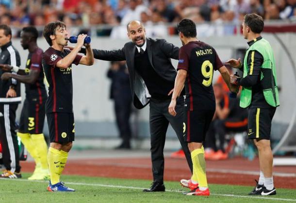 Silva, Guardiola y Nolito en Bucarest. Foto: Reuters
