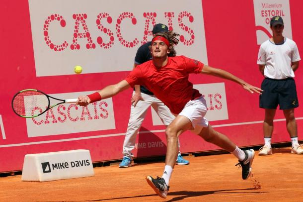 Stefanos Tsitsipas hitting a forehand at the Millennium Estoril Open. (Photo by Millennium Estoril Open)