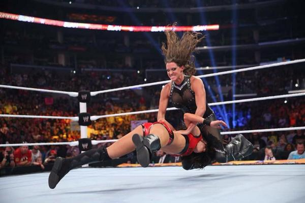 Stephanie McMahon hitting the pedigree on Brie Bella at SummerSlam (image: twitter)