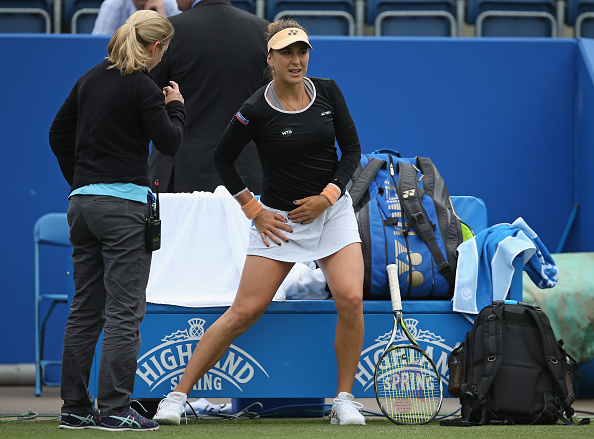 Bencic receives treatment from a physio before retiring against Irina-Camelia Begu in Birmingham (Getty/Steve Bardens)