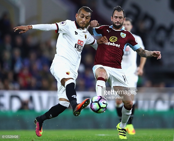 Steven Defour battles for possession