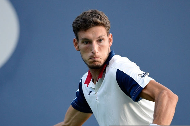 Photo: Steven Ryan/Getty Images-Carreno Busta hits a forehand winner.