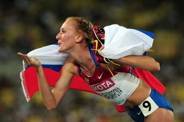 Yulia Zaripova celebrates her 2011 World Championships gold, which she has now been stripped of (Getty/Stu Forster)