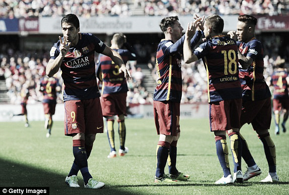 Above: Luis Suarez celebrates one of his two goals in Barcelona's title-winning 2-0 win over Granada | Photo: Getty Images