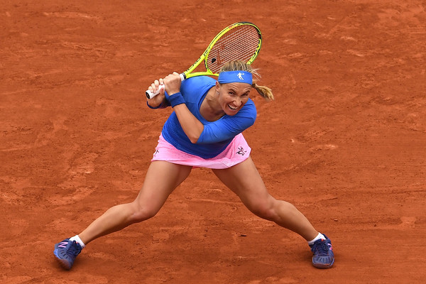 Svetlana Kuznetsova slides on the Paris clay courts last year | Photo: Dennis Grombkowski/Getty Images Europe