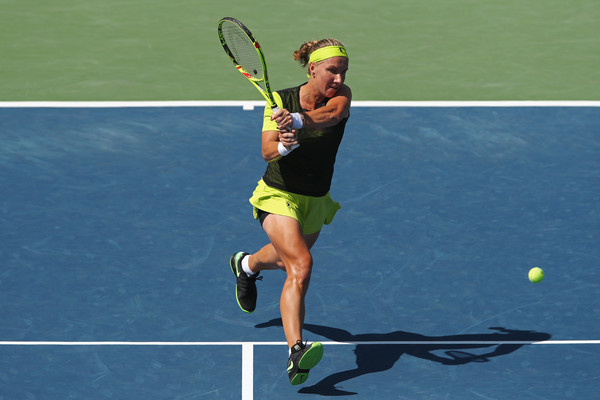 Svetlana Kuznetsova hits a backhand near the net | Photo: Matthew Stockman/Getty Images North America