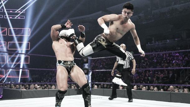 Perkins hits a spinning heel kick. Photo- WWE.com