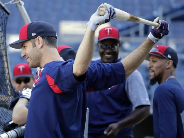 Joe Mauer (l.) works out on Monday in preparation for the AL Wild Card Game/Photo: Frank Franklin II/Associated Press