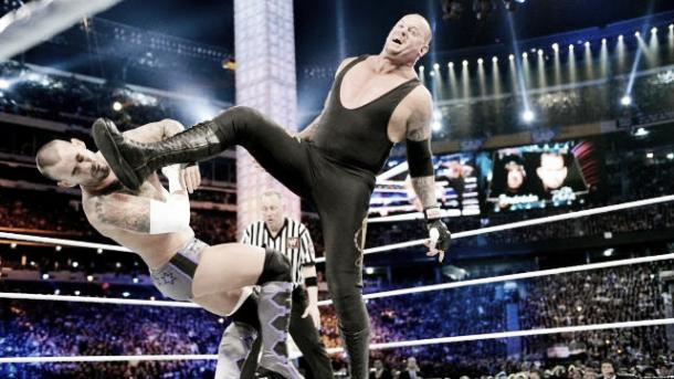 Taker big booting CM Punk (411mania.com)