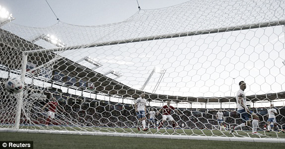 Above: Neil Taylor's goal hitting the back of the net in Wales' 3-0 win over Russia | Photo: Reuters