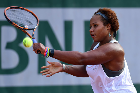 Taylor Townsend slices a backhand in her 2014 French Open upset over Cornet. Photo: Matthias Hangst/Getty Images