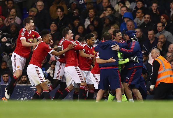 Joel Pereira and his teammates celebrate after Varela's goal | Photo: Julian Finney/Getty Images