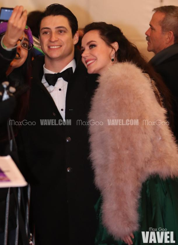 Selfie, anyone? Canadian sweethearts Tessa Virtue and Scott Moir pose for a picture with a fan on the red carpet, with astronaut Chris Hadfield trailing not too far behind them.