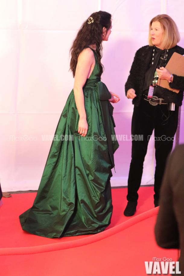 Gorgeous in Green: Tessa Virtue looked stunning in an emerald green gown by Spanish designer Yolancris, and wore a pink ostrich feather jacket by Fox the Label when she originally entered the red carpet.