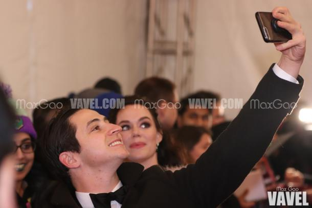 Say cheese! Scott Moir poses for a selfie with a fan on the red carpet.