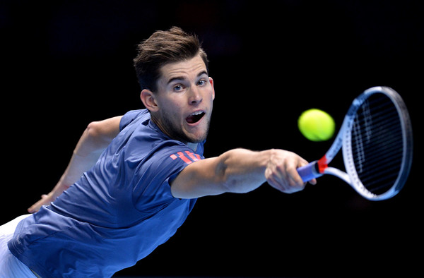 Dominic Thiem lunges for a backhand during his loss to Raonic. Photo: Justin Setterfield/Getty Images