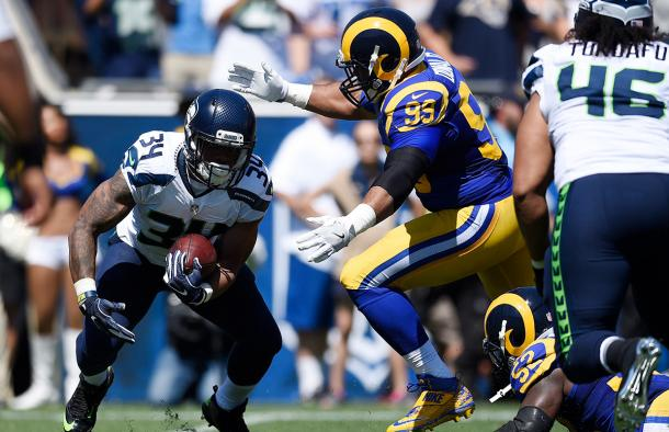 Thomas Rawls struggled in the last game he appeared in for the Seattle Seahawks. He carried the ball seven times for minus seven yards against the Los Angeles Rams | Source: Kelvin Kuo - AP Photo