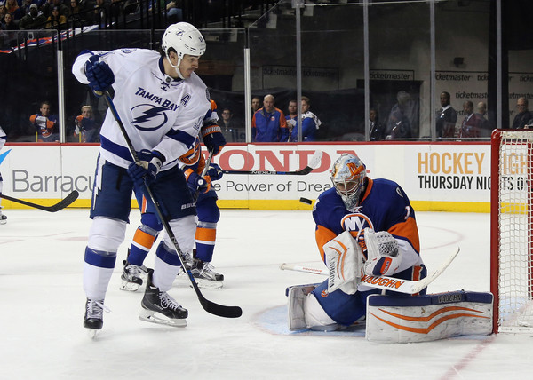 Thomas Greiss #1 of the New York Islanders makes the third period save as Brian Boyle #11 of the Tampa Bay Lightning looks for the rebound at the Barclays Center on April 4, 2016 in the Brooklyn borough of New York City. The Islanders defeated the Lightning 5-2. (April 3, 2016 - Source: Bruce Bennett/Getty Images North America)