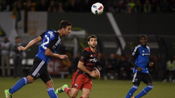Portland's Diego Valeri eyeing to steal the ball from San Jose's defender Andrés Im