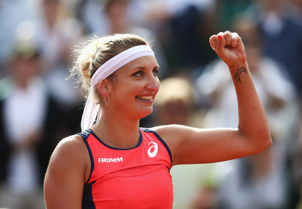 Timea Bacsinszky celebrates her win over Venus Williams | Photo: Julian Finney/Getty Images Europe