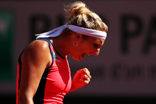 Timea Bacsinszky celebrates winning a hard-fought point | Photo: Clive Brunskill/Getty Images Europe