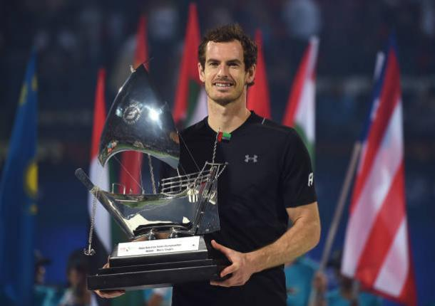 Andy Murray poses with the title after winning in Dubai (Getty/Tom Dulat)
