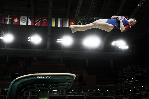  Aliya Mustafina of Russia performing a 15.1 vault routine in the Team Finals. Photo Credit: Tom Pennington of Getty Images South AmericaAliya Mustafina of Russia performing a 15.1 vault routine in the Team Finals. Photo Credit: Tom Pennington of Getty Images South America Click and drag to move 